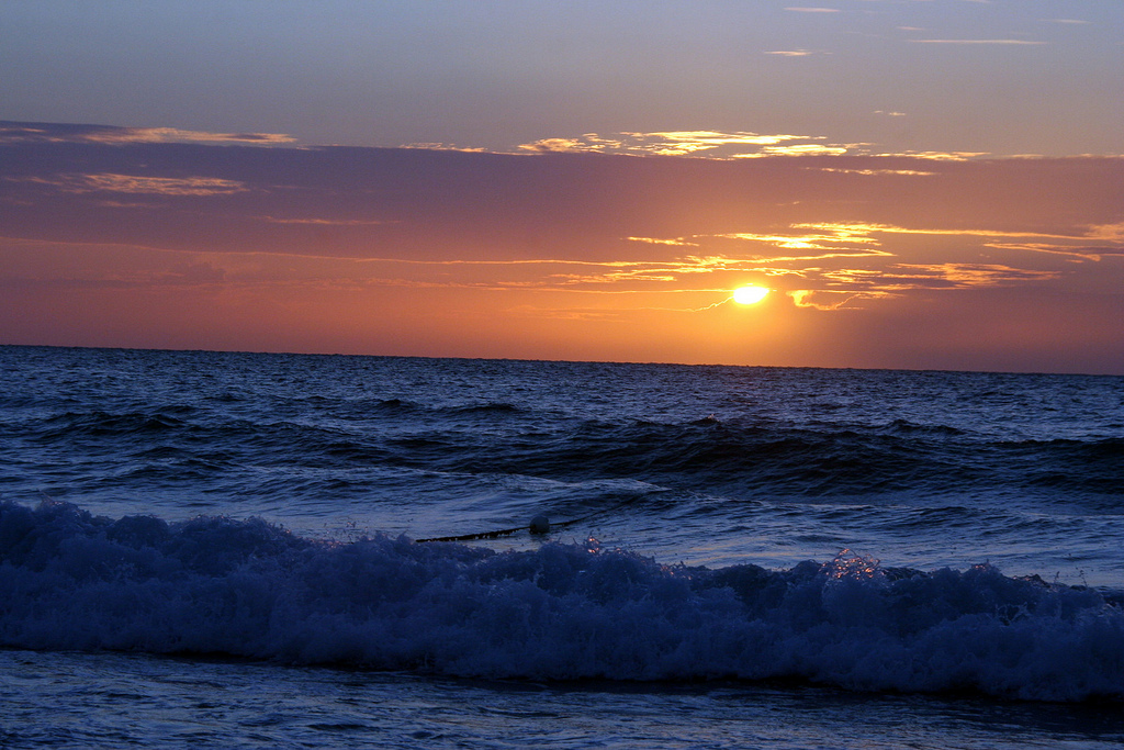 Закат на пляже. Автор: runkalicious. Фото:  www.flickr.com