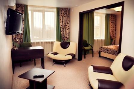 Люкс, гостиная. Фото от представителей отеля.