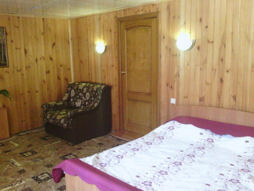 Общий вид спальни номеров коттеджа Famyli Haus