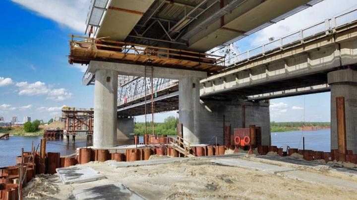 Рабочее движение по новому мосту-дублеру в створе улицы Мельникайте запустят в октябре