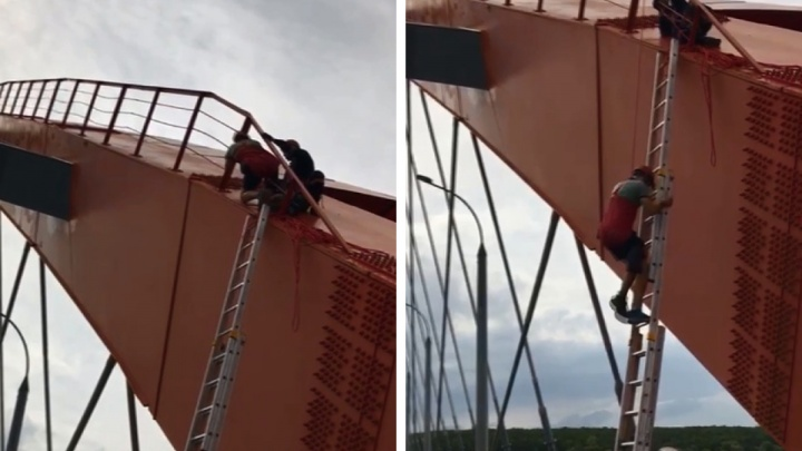Новосибирец забрался на арку Бугринского моста — снимать его пришлось спасателям
