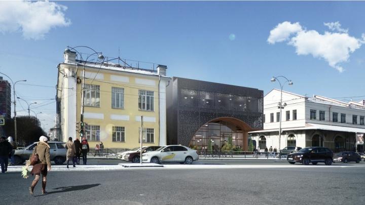 Между историческими зданиями в центре города построят магазин в виде ультрасовременной арки