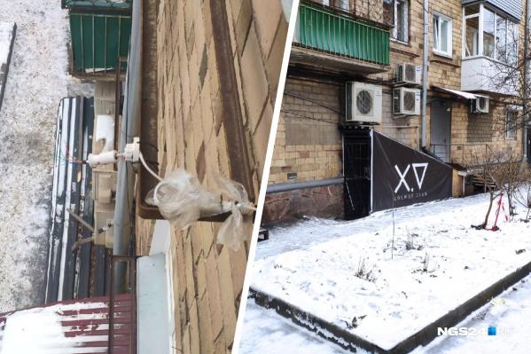 Слева — то, что осталось от камеры видеонаблюдения, висевшей на третьем этаже. Справа — вход в бар