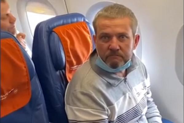 Алексей Лагунин во время экстрадиции в Россию