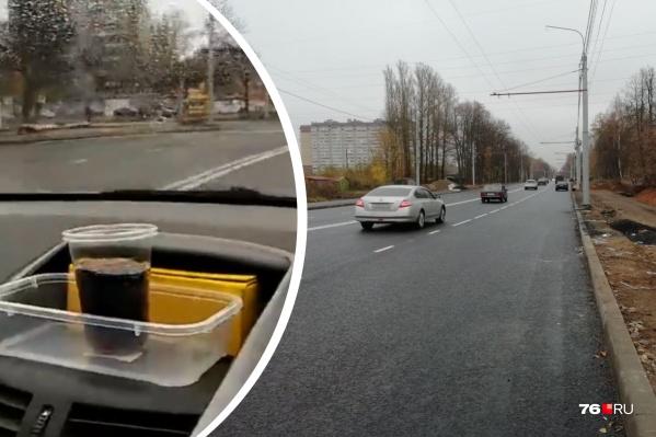 Со стаканом мы проехали отремонтированный участок Тутаевского шоссе в обоих направлениях