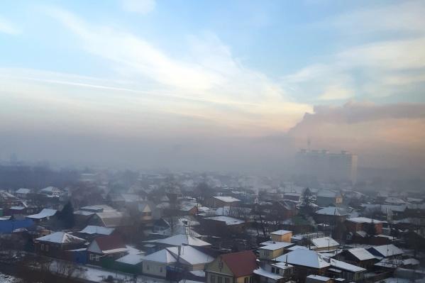 Утром центр города был затянут смогом