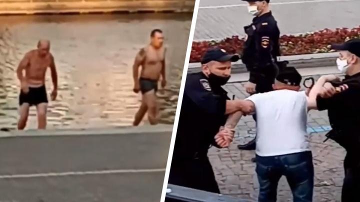 Полиция задержала искупавшихся на Плотинке мужчин, их увели в наручниках: видео