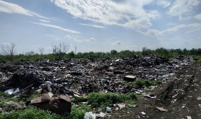 С площадок временного накопления на Кегострове начали вывозить мусор