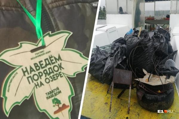 Участники акции собрали полный автомобильный прицеп мусора с берегов озера
