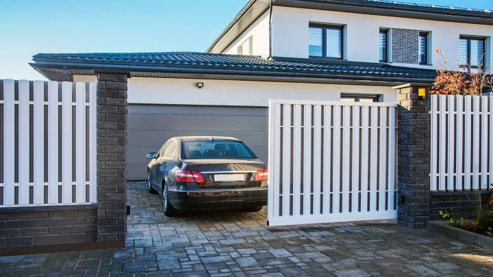 Выбираем ворота для гаража: типы, преимущества и особенности