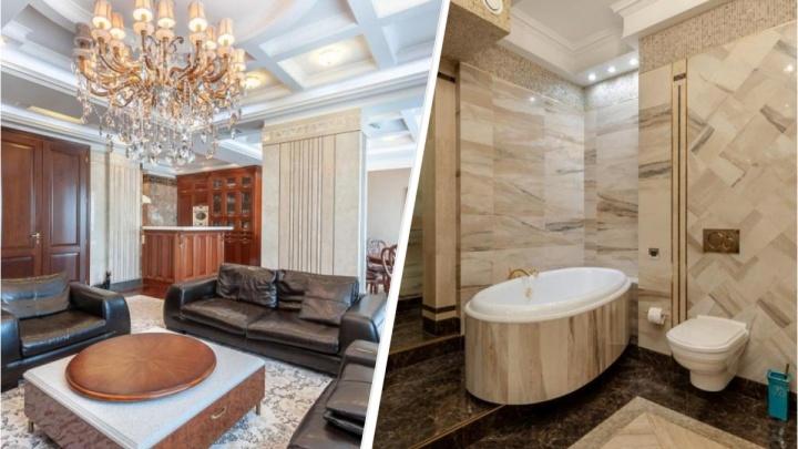 Квартира по цене коттеджа: в Екатеринбурге продают четырехкомнатное жилье в доме на набережной Исети
