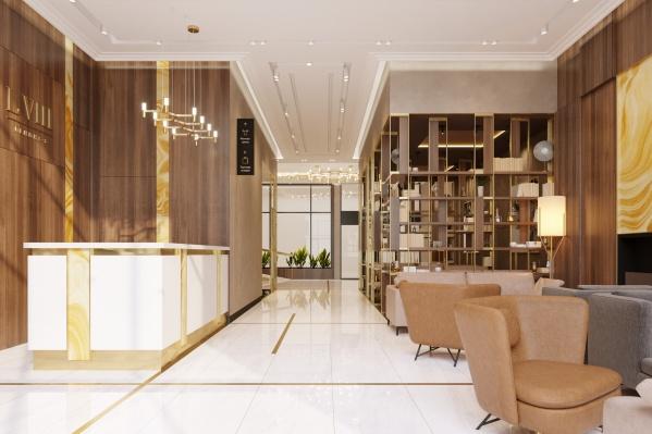 Холл первого этажа нового клубного дома в центре Екатеринбурга — это комфортное пространство, где можно деловую встречу провести