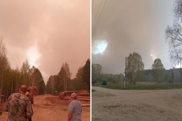 Люди видят дым от огня всего в нескольких километрах от поселка