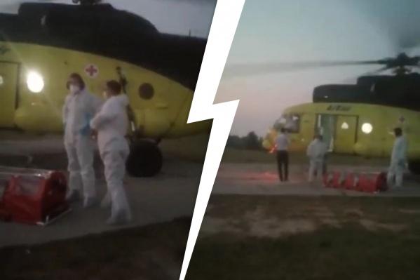 Местные жители криками и матом прогнали врачей в защитных костюмах