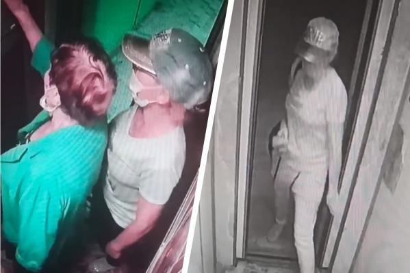 Женщина старательно скрывала лицо от камер