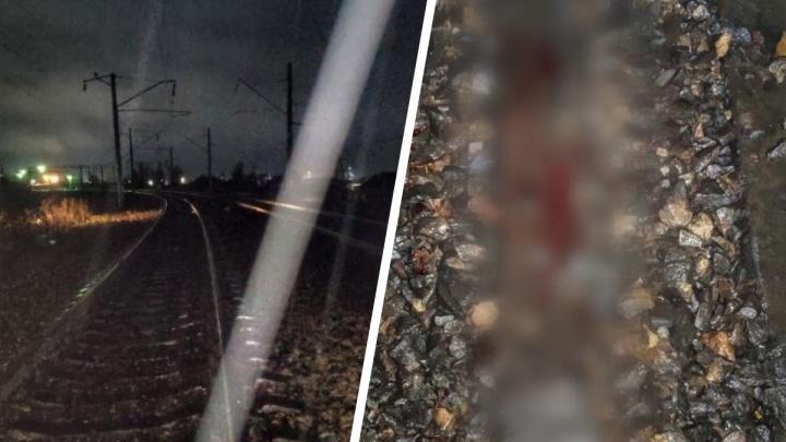 Толпа надругалась над 27-летним парнем в поселке под Красноярском, а потом бросила его под поезд