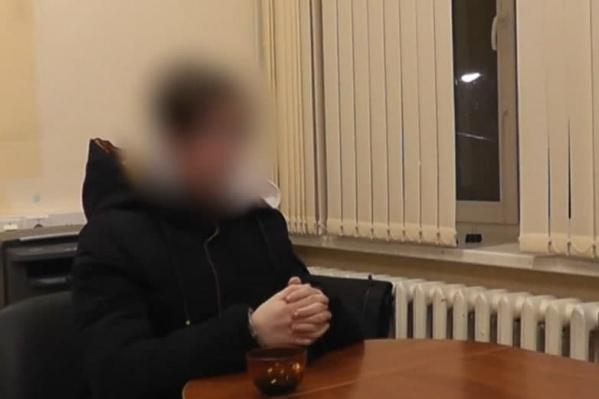 Фото парня, сделанное во время допроса