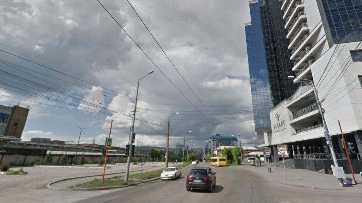 Владелец элитного бизнес-центра «Баланс» выиграл место под огромную парковку напротив своего здания