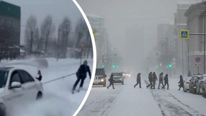 Красноярец зацепился тросом к машине и проехался по свежевыпавшему снегу на Мичурина