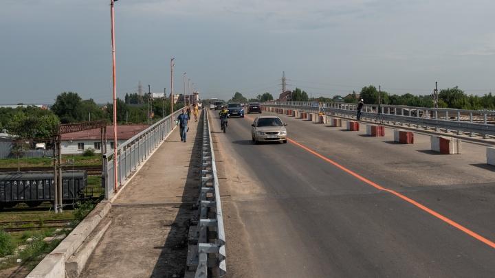Семь месяцев в ожидании двух полосок: фоторепортаж с частично открытого моста на Малиновского