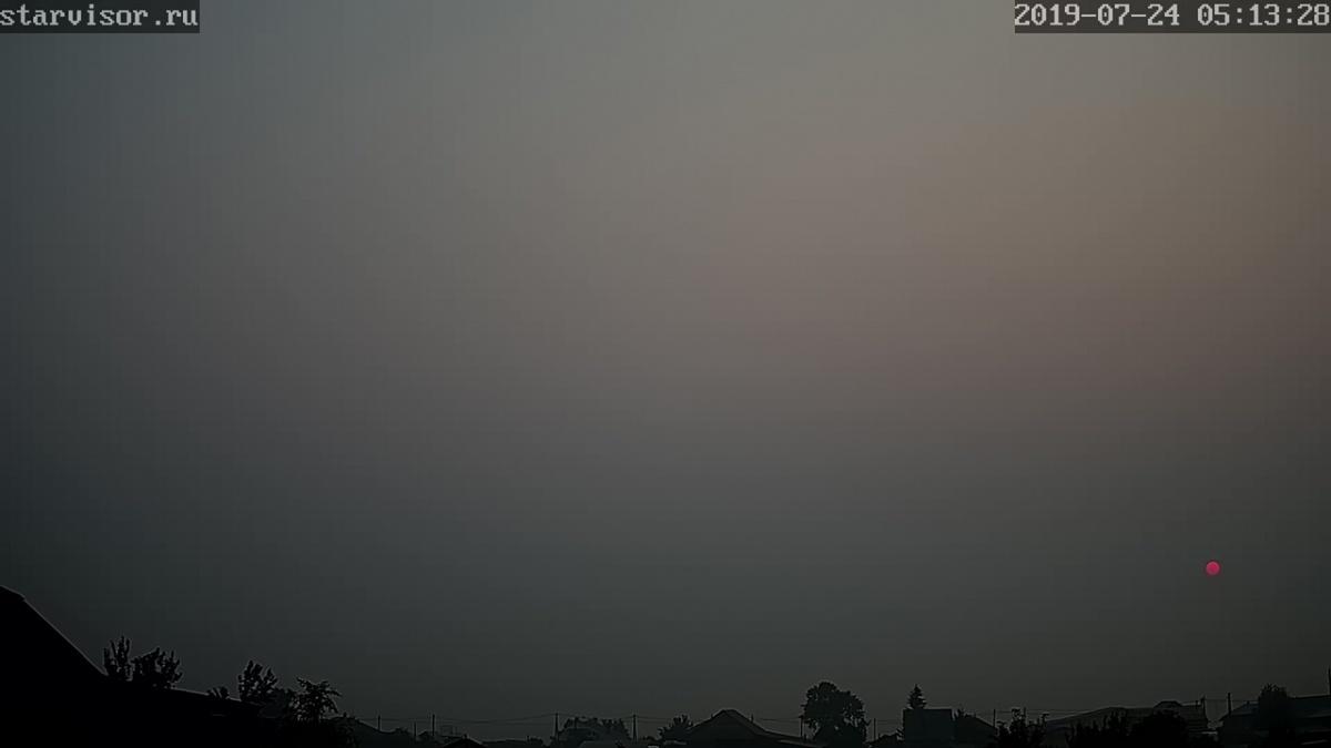 Дым от сибирских лесных пожаров утром 24 июля 2019 года
