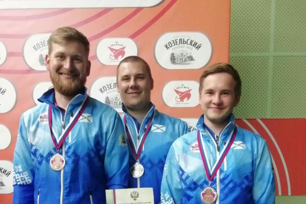 Леонид Екимов, Сергей Соловьев иМихаил Исаков с бронзовыми медалями