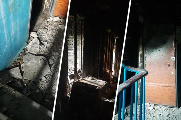 В обгоревшем состоянии квартира и подъезд по Ломакина, 20 стоят и по сей день