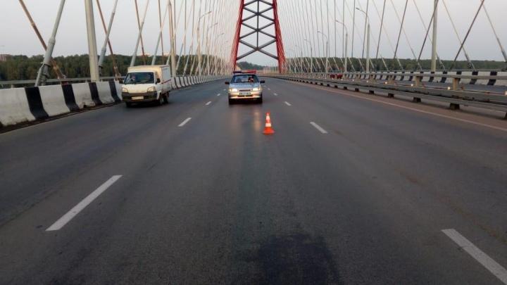 Водитель получил срок за сбитого на Бугринском мосту пешехода с флагом ВДВ