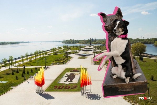 На фото рядом со статуей ещё один пёс из приюта, который пошёл на службу