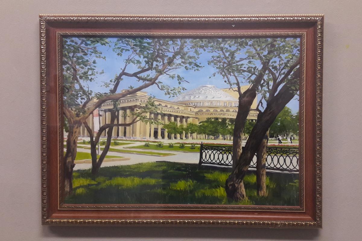 На одной из таких картин, которые пишут художники для чиновников, изображён оперный театр и сквер у него