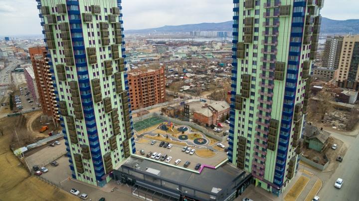 Странные разноцветные башни на Копылова: новосёлы о том, стоит ли там жить