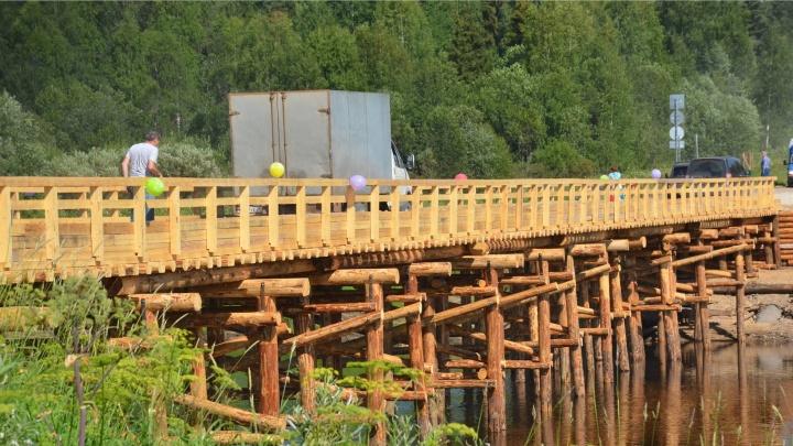 В Холмогорском районе за месяц построили новый мост через Ваймугу