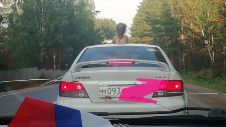 Водитель получил штраф за ребёнка в люке и объяснил, как это произошло