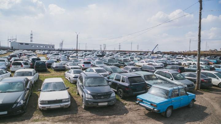 У четверых красноярцев забрали машины за долги по «коммуналке»