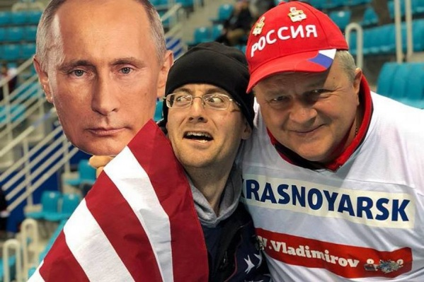 Снимки сибиряка и американца с портретом Путина облетели мировые СМИ