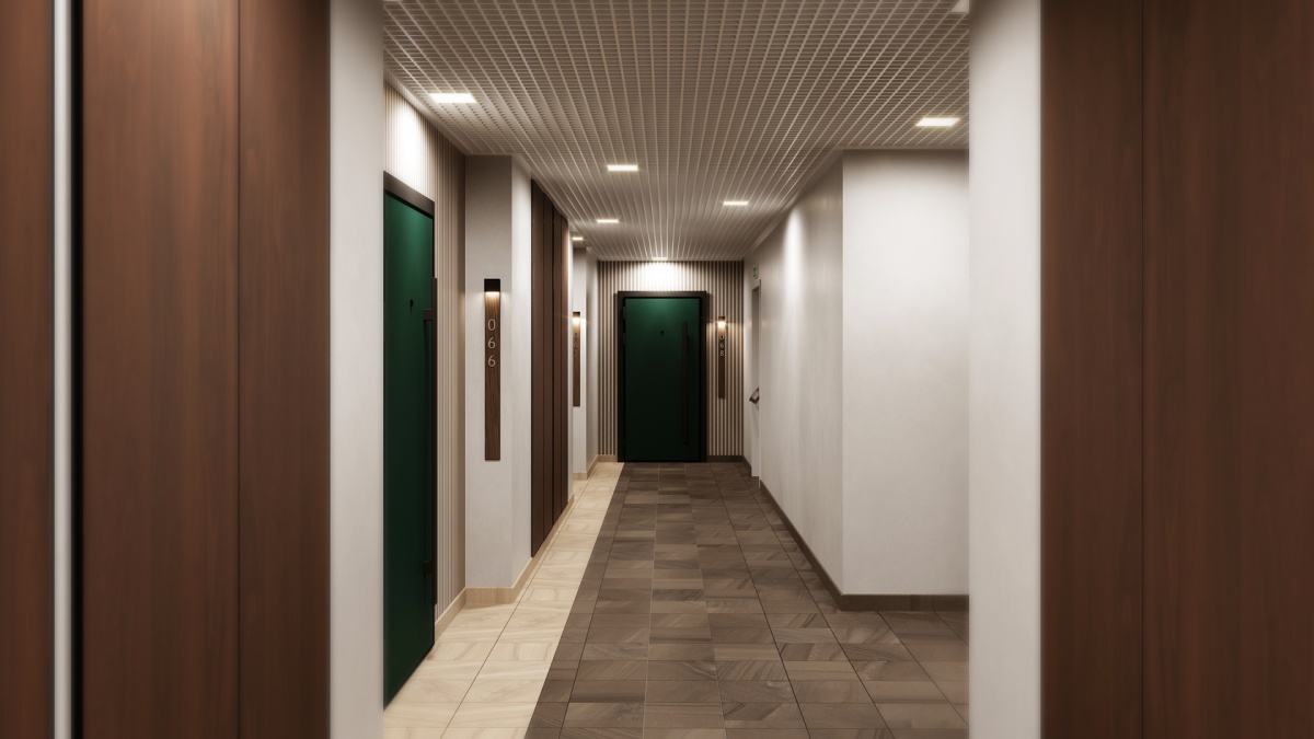 В интерьере этажных холлов будут использоваться материалы природных оттенков, на полу — керамогранит, на стенах — панели из дерева