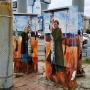 Осенние краски и столбы-деревья: челябинские художники изменили перекрёсток у «бойца с пистолетом»