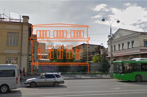 За бетонным забором, на котором постоянно появляются граффити, должны построить новое здание
