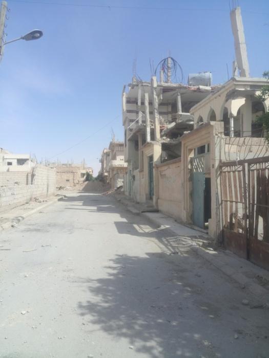 На фото разрушенные дома в Акербате