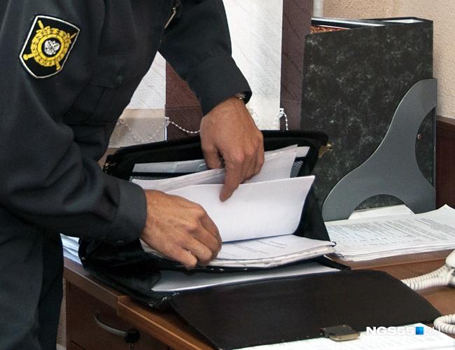 ВОмске прежнего следователя милиции обвиняют вполучении взятки