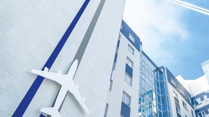 Рядом с городским аэропортом достраивают дом с взлетающим самолетом на фасаде