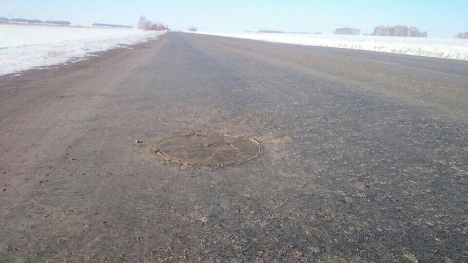Заплатка на дороге зимой