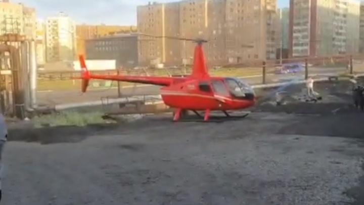Посадившего вертолет у гаражей в Норильске пилота оштрафовали