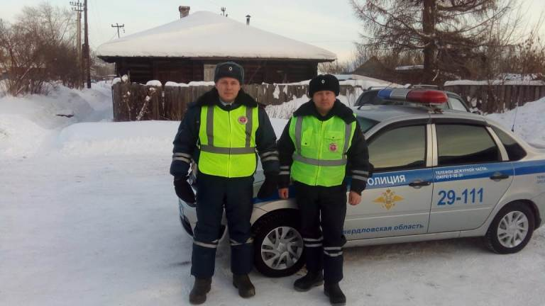Сотрудники ГИБДД Александр Юркевич и Андрей Чухломин