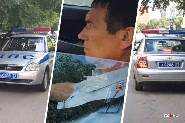 На этом служебном автомобиле инспектор нарушил Правила дорожного движения. Прохожий снял это на камеру мобильного телефона