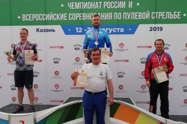 На фото — Леонид Екимов и его тренер Александр Поздеев<br>