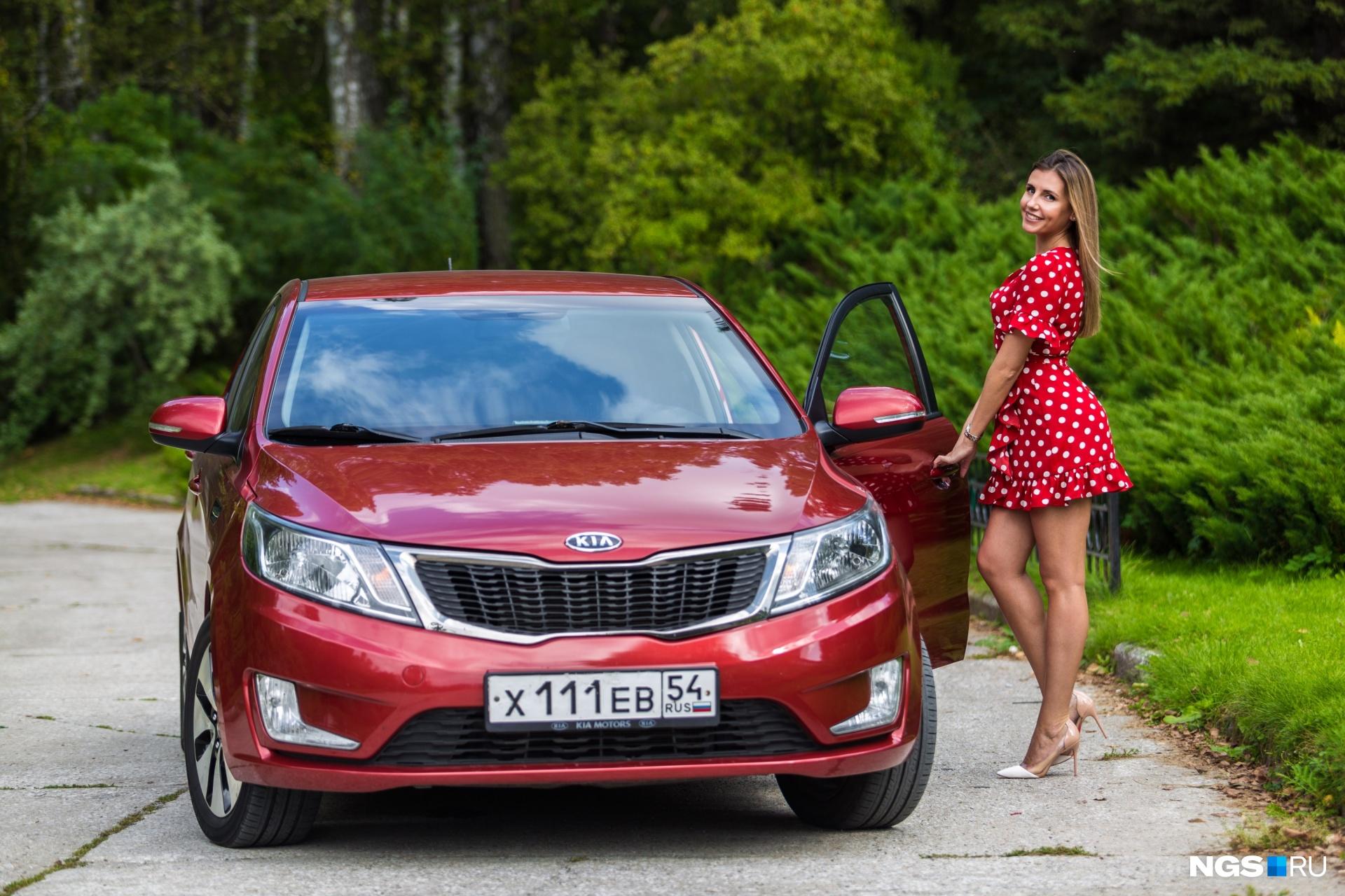 Красная KIA — первая машина Евгении