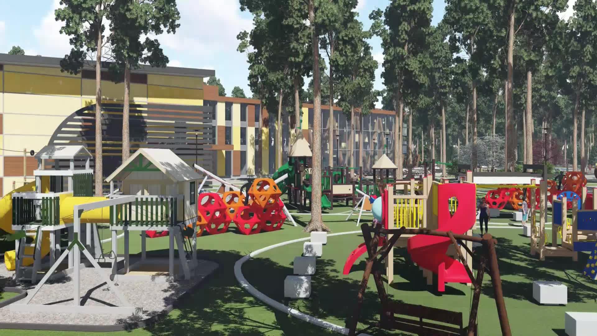 На огромной детской площадке тоже немало спортивных конструкций