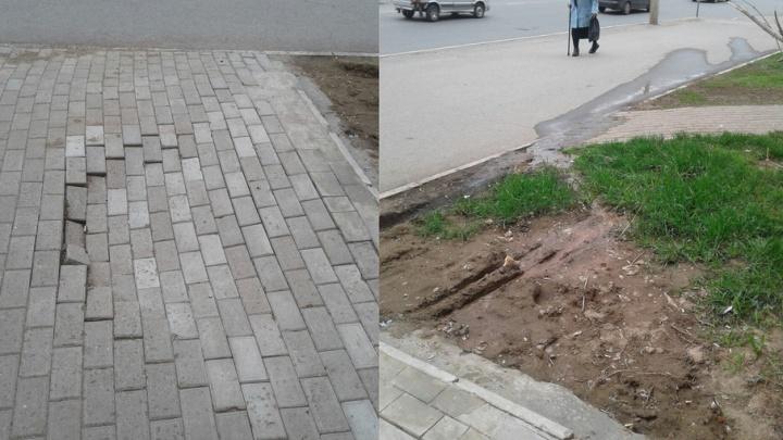 В центре Уфы проваливается тротуарная плитка, а по улице течет вода