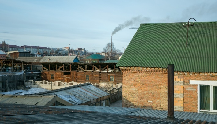 Жители подали коллективную жалобу на хозяйку угольного склада, отравляющего им жизнь